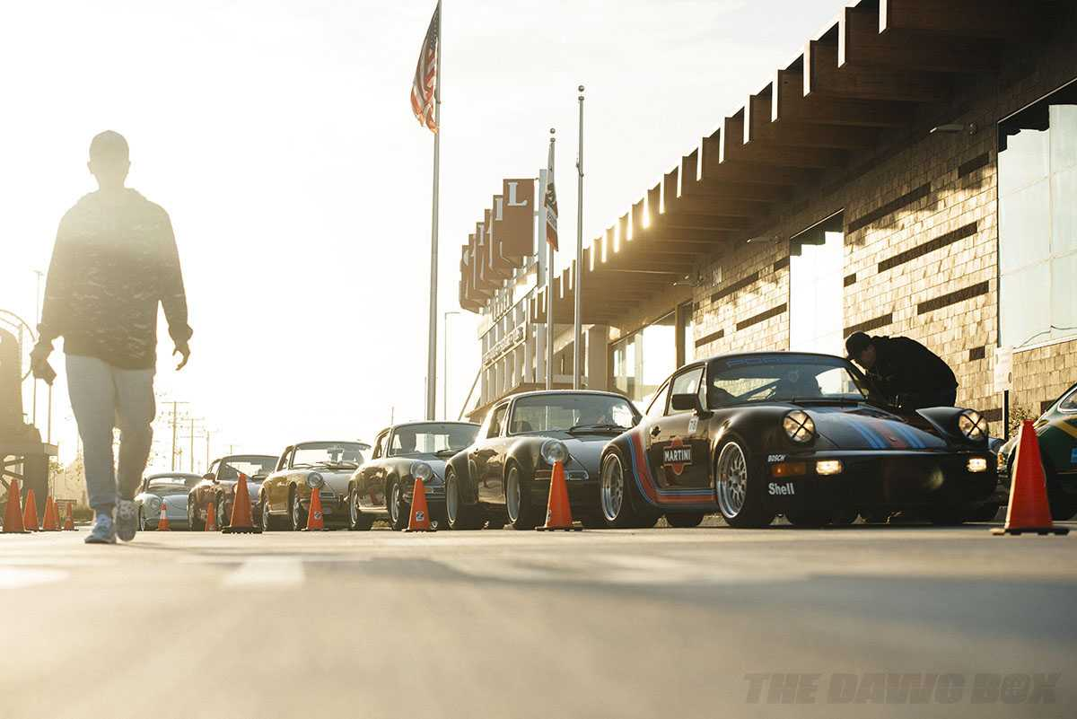 several classic porshes lined up for display