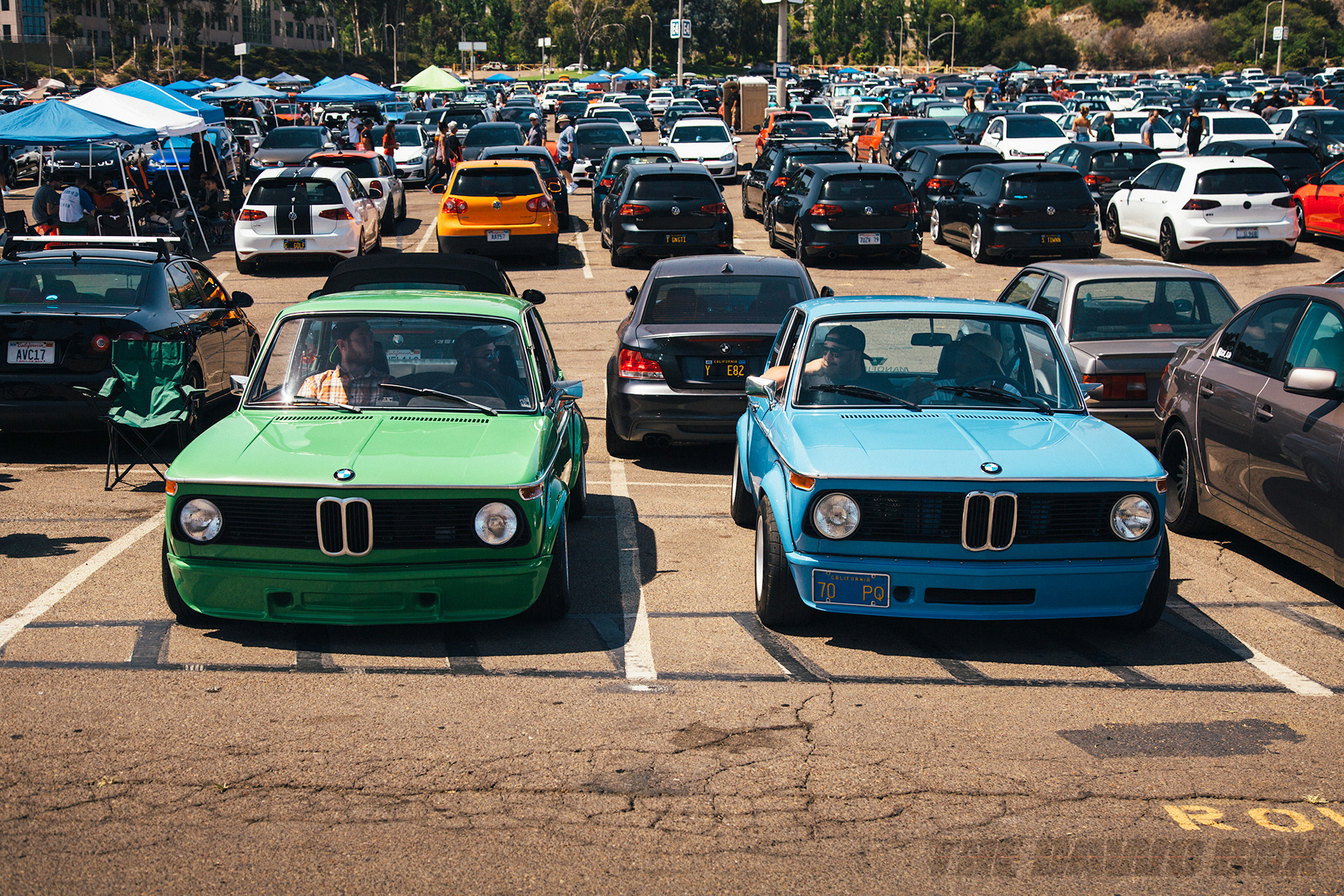 A pair of classic blue and green BMW's on display at Big Socal Euro