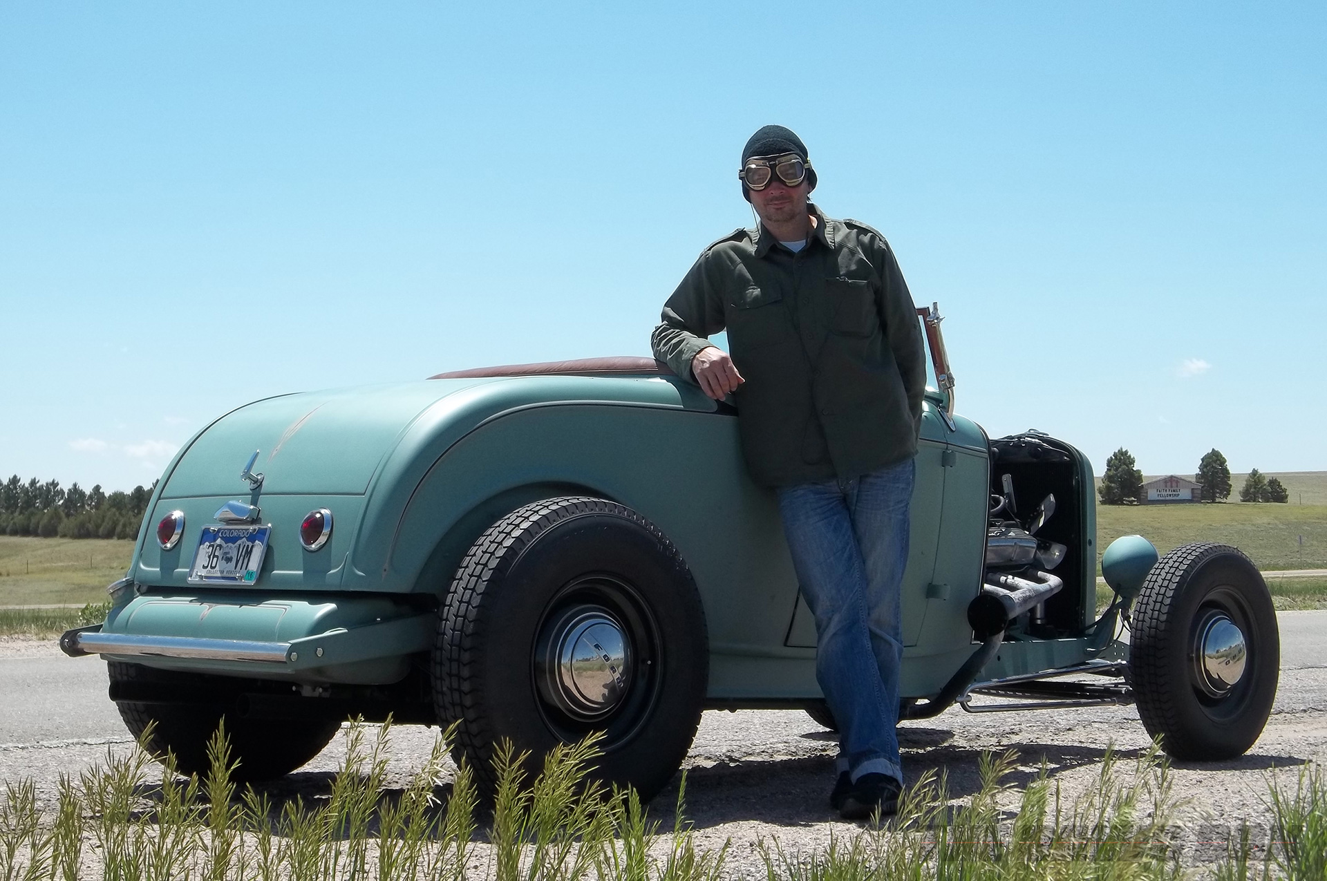 Tony Thacker posing next to Henry Astor's '32 Ford Roadster
