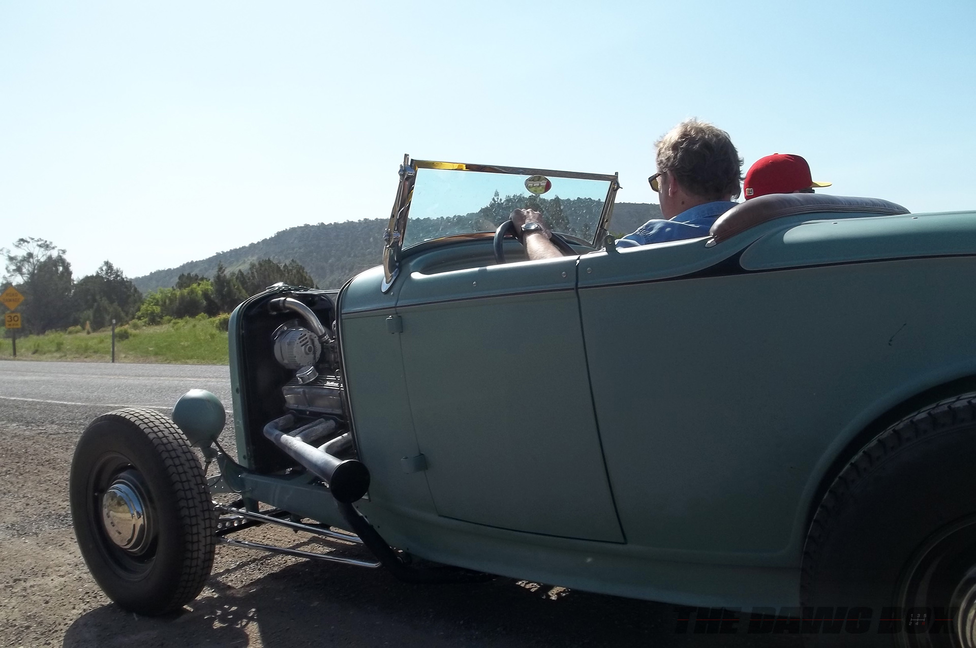 Henry Astor's '32 Ford Roadster being driven down the countryside