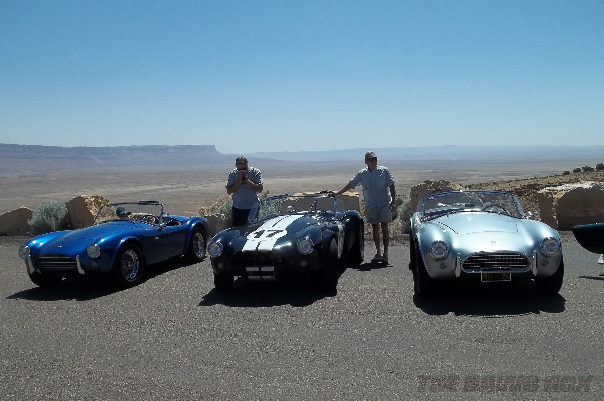 Blue, Black, and silver Shelby AC Cobras posed at the Grand Canyon