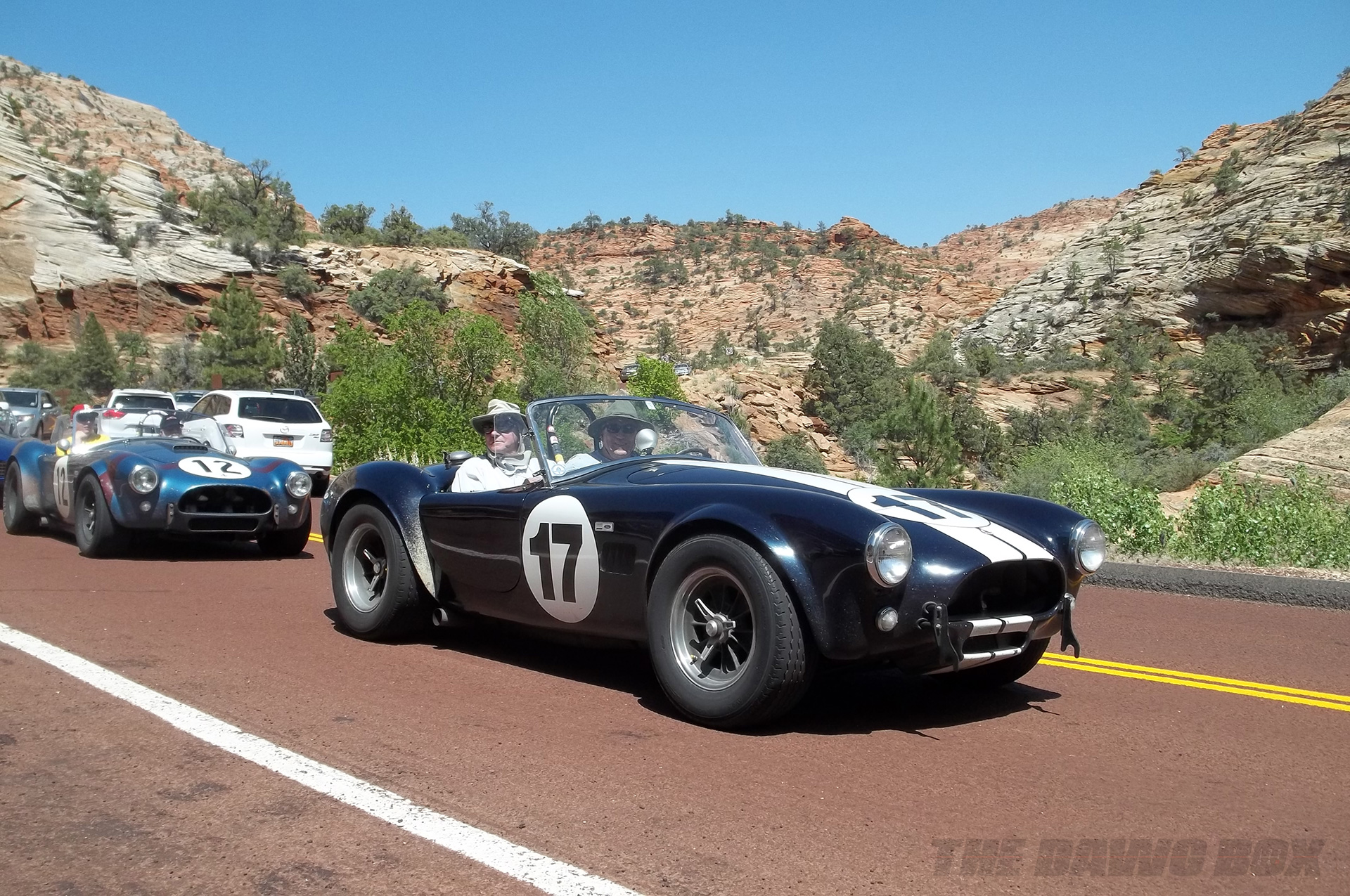 a black and blue Shelby AC Cobra on a scenic grand Canyon highway