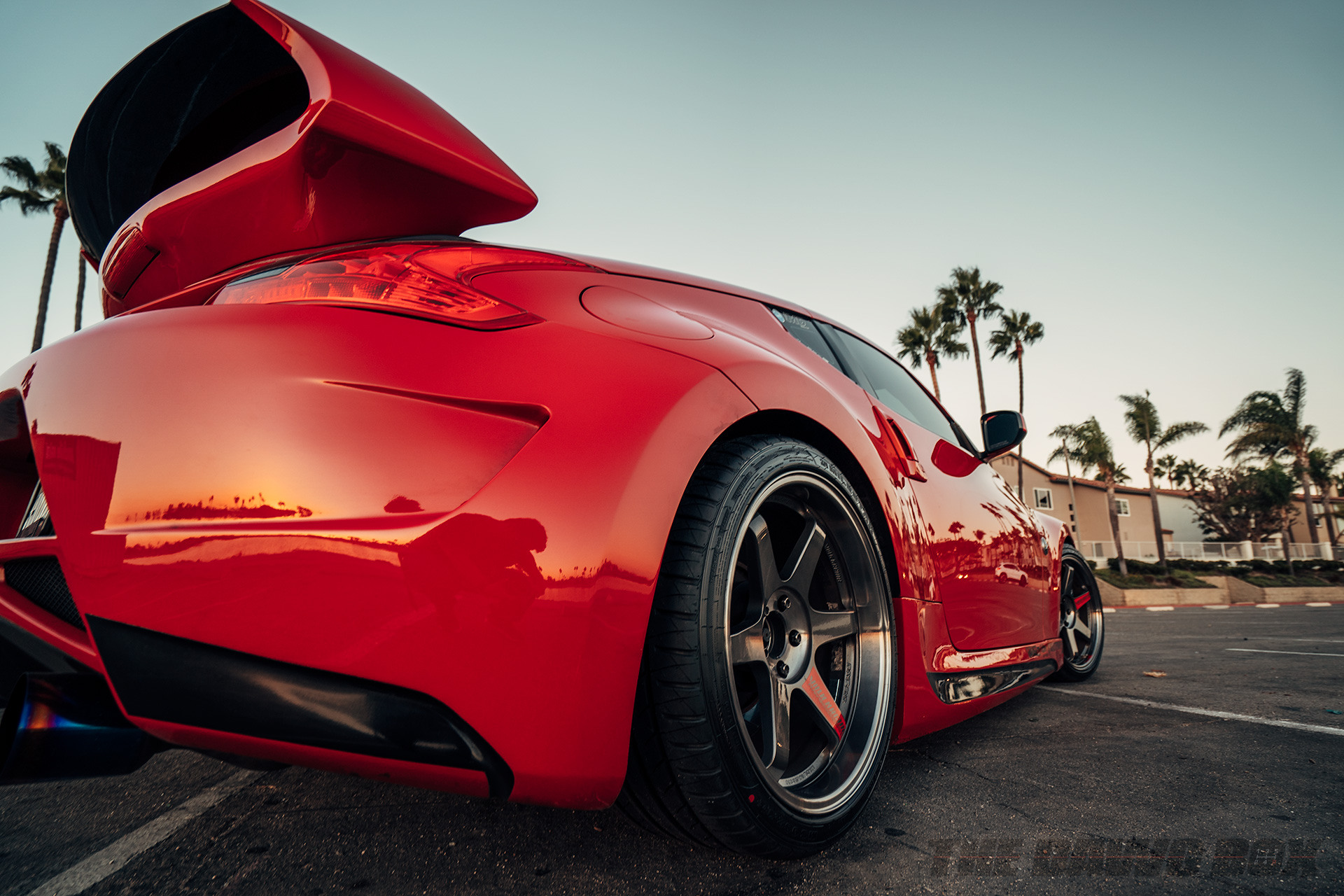 close up rear shot of a red Nissan 370z with Milestar Tires MS932 XP+ tires