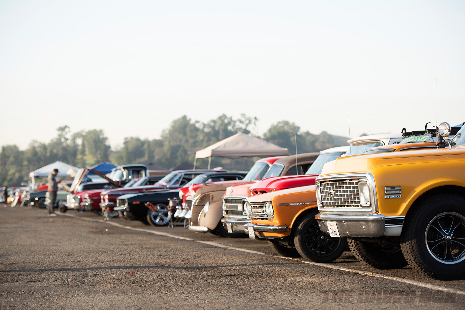 a line of classic chevys. datsuns, fords, and more on display at the In-N-Out Hot Rod 70th Celebration