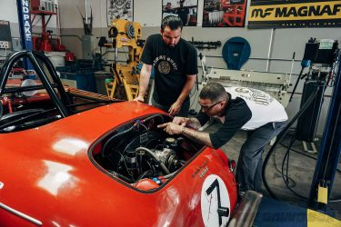 Jimmy and his assistant working on the Porsche Speedster engine
