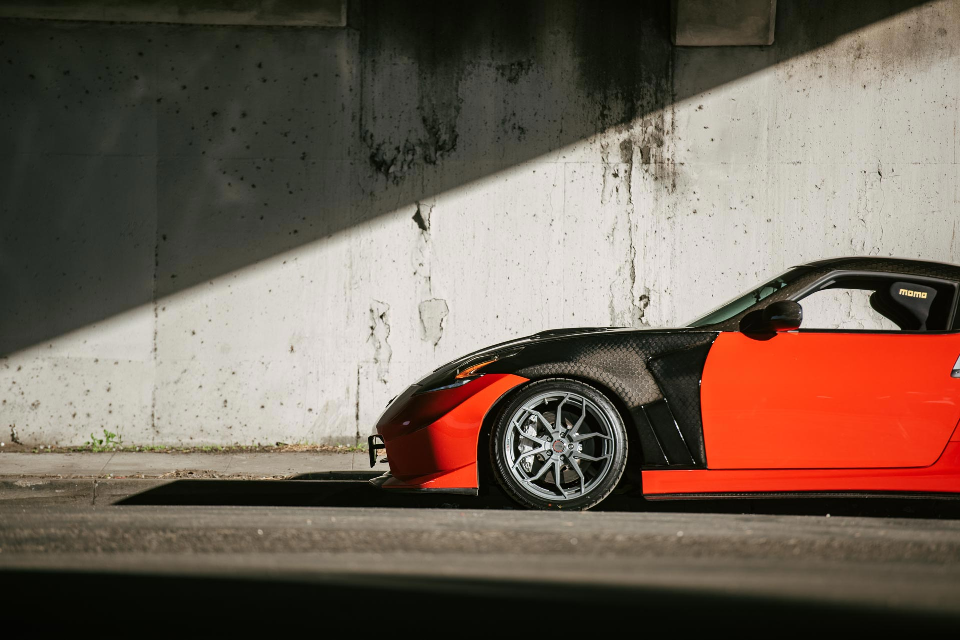 Nissan 370Z with carbon fender flares and Milestar UHP tires