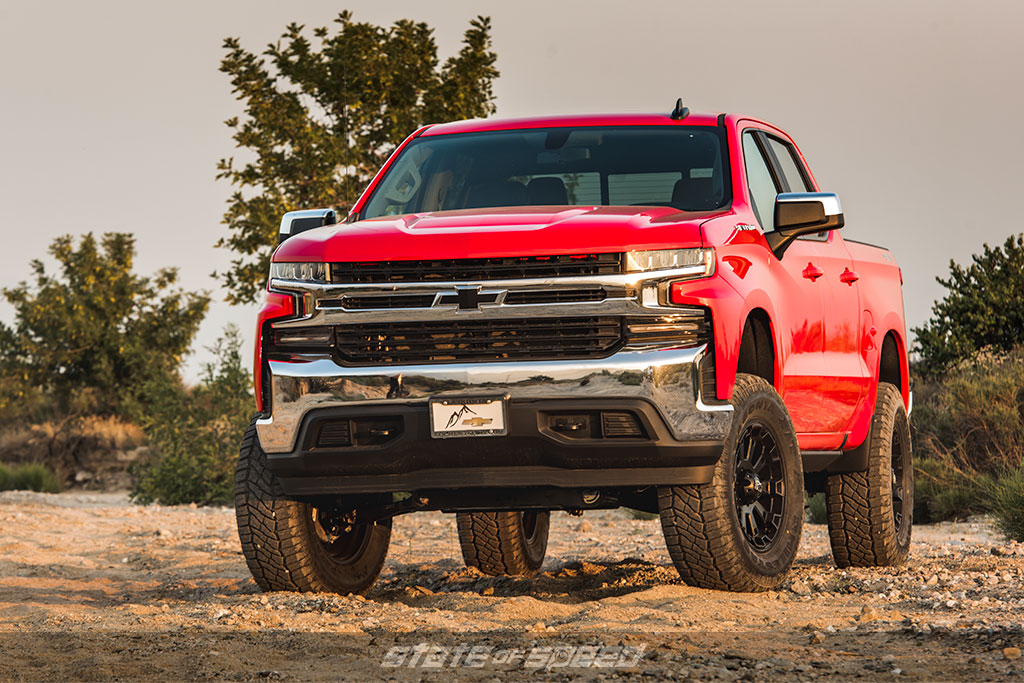 Red pickup truck with offroad tires