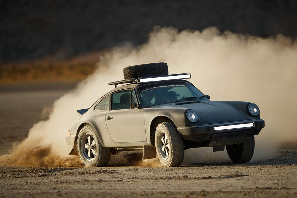 Kelly Moss Racing built porsche 911 safari driving in the dirt