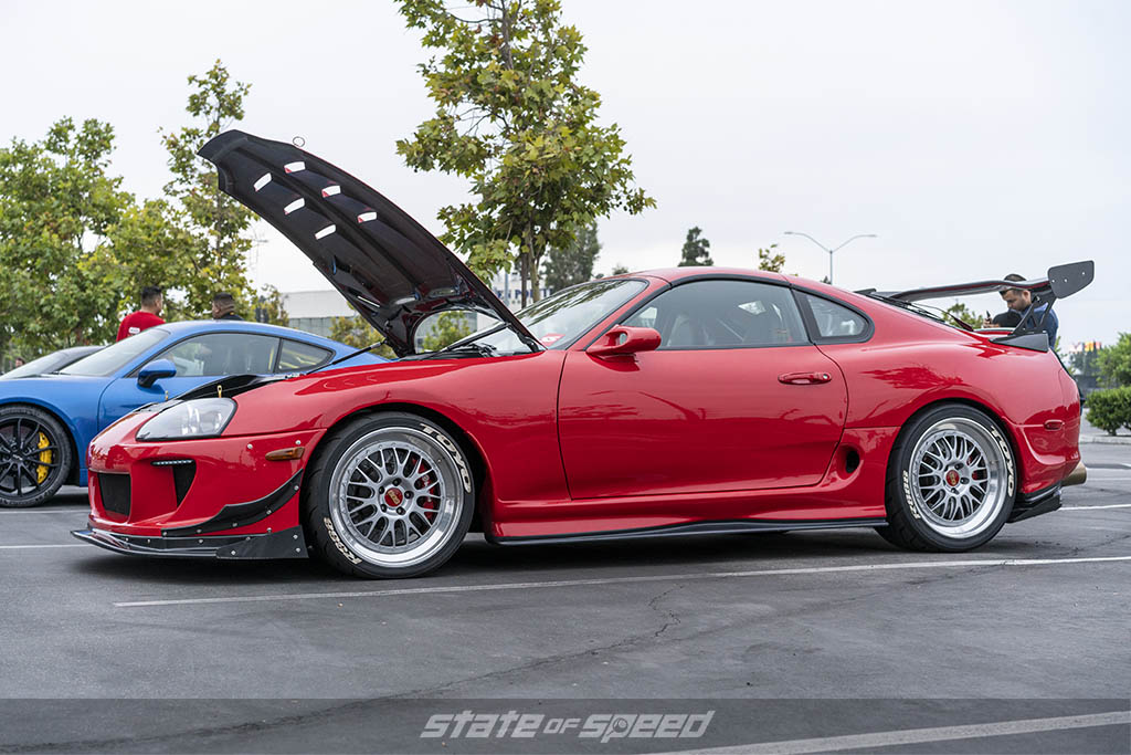 red toyota supra with hood open