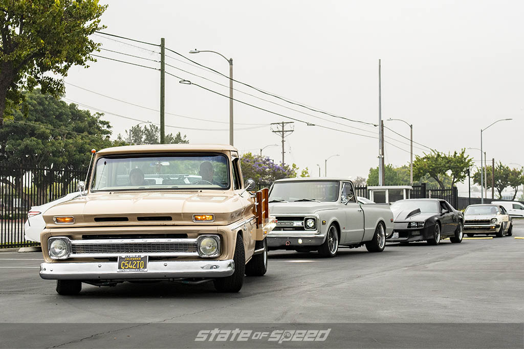 Brown first gen Chevrolet C10 pick up truck, grey second gen Chevrolet C10, and Black third gen chevrolet camaro at State of Speed Los Angeles LA