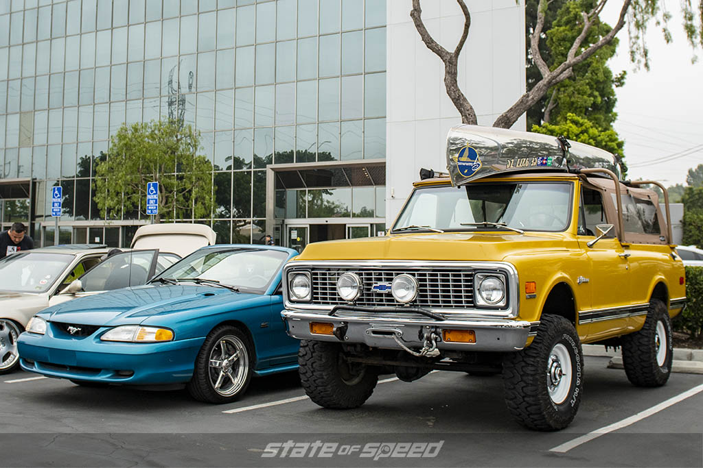 Teal Ford Mustang 4th gen and mustard yellow Ford Bronco at State of Speed Los Angeles LA