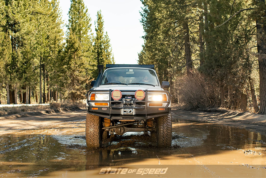 Toyota Land Cruiser rolling through mud with Milestar Patagonia MT Offroad Tires