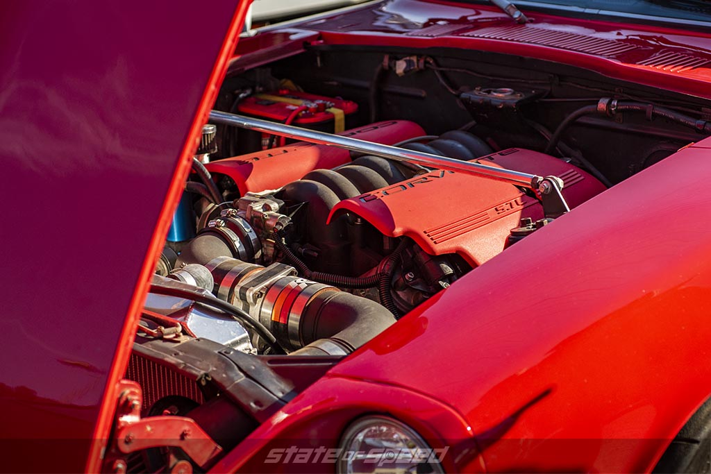 Modern Day Pushrod Engine in the form of an LS6 Engine from a Corvette inside a red datsun 240z