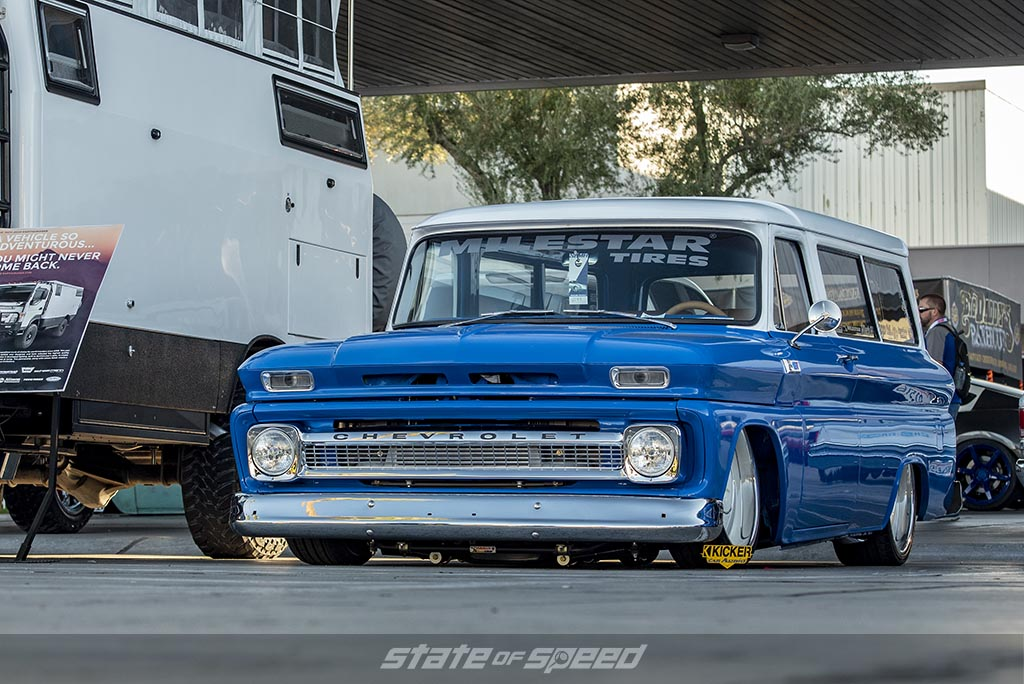 Blue and white Chevrolet C-10 Restomod with custom bed cap
