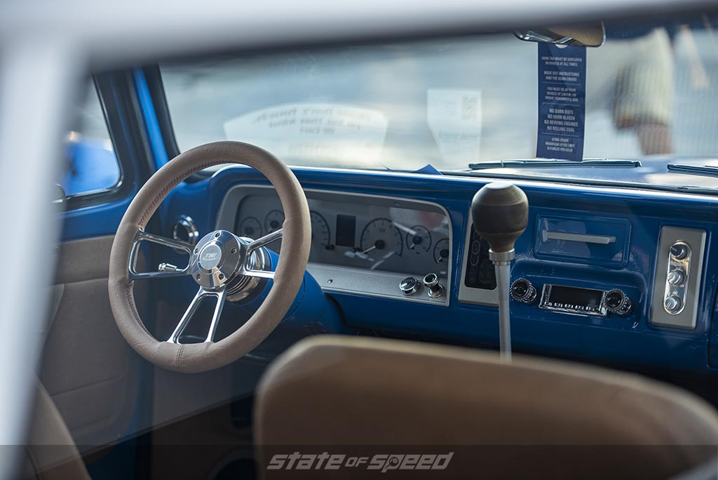 interior shot of a Blue and white Chevrolet C-10 Restomod with custom bed cap