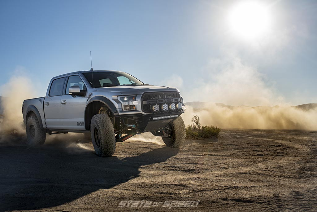 Silver Ford F-150 Raptor Gen 2 with suspension upgrades and wide body kit by SVC