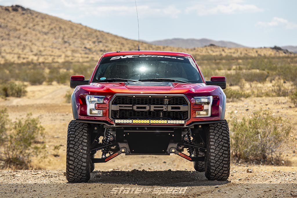 Red Ford F-150 Raptor gen 2 modified by SVC in a desert
