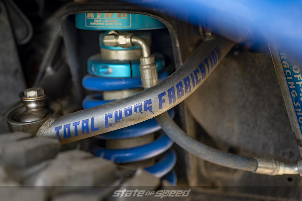Blue and silver Total Chaos Fabrication Upper Control Arm UCA and King Coilovers with oil reservoir